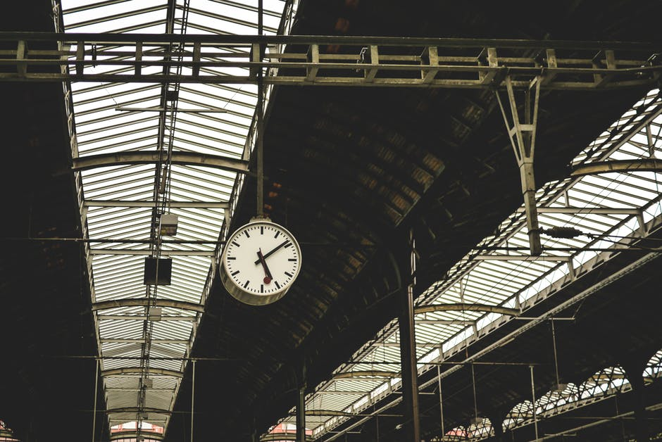 Clock hanging in train station